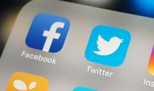 iphone displaying facebook and twitter application icons
